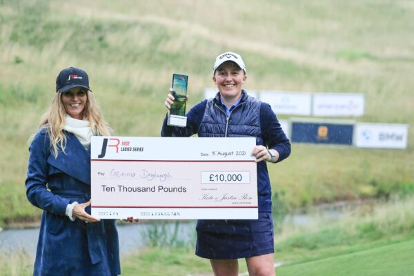 UTTOXETER, ENGLAND - AUGUST 05: Gemma Dryburgh of Scotland is presented with the winner's trophy and cheque  by Kate Rose after her win in the Rose Ladies Series at JCB Golf & Country Club on August 05, 2021 in Uttoxeter, England. (Photo by David Cannon/Getty Images)